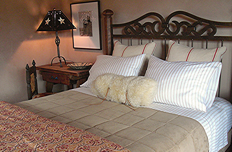 Interior Design for master bedroom with custom duvet cover and sheepskin neckroll