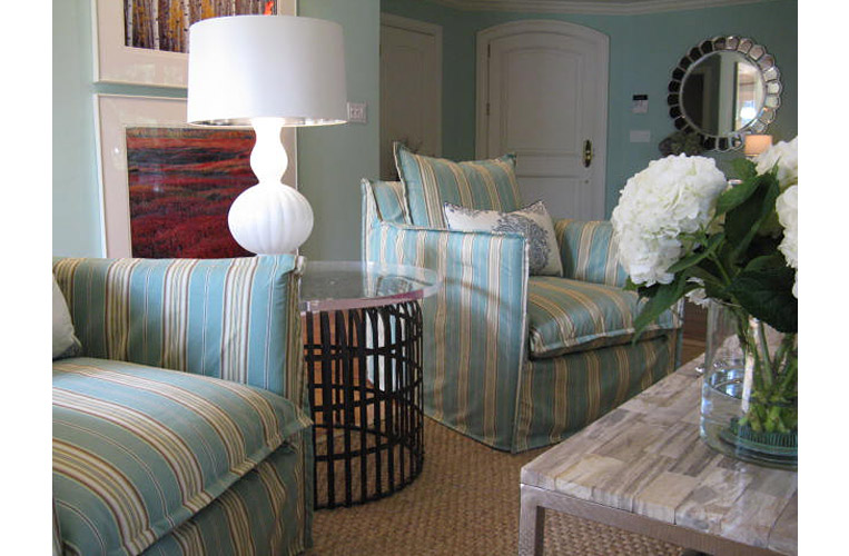 Interior design by Karen Lievense using slipcovered swivel armchairs provide comfort and ease