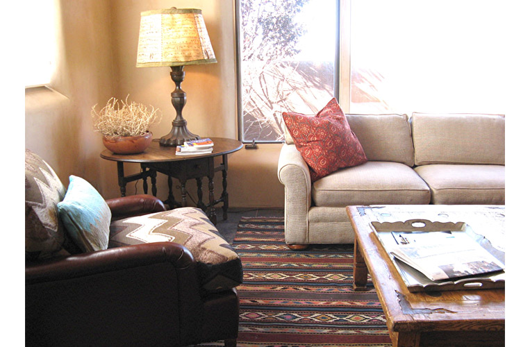 Interior design by Karen Lievense with antique kilim rug and custom leather/chenille club chair